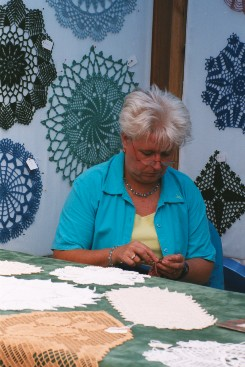 Woman Crocheting Doilies